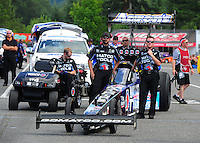 Aug. 7, 2011; Kent, WA, USA; NHRA top fuel dragster crew members for driver Antron Brown during the Northwest Nationals at Pacific Raceways. Mandatory Credit: Mark J. Rebilas-
