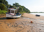 Fishing boat and dinghies beach at The Rocks on the River Deben near Ramsholt, Suffolk, England, UK