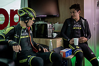 as it is a super rainy stage 5 start; riders stay in the dryness of the teambus for as long as possible before the actual race start; as here with Esteban Chavez (COL/Mitchelton-Scott) & Christopher Juul-Jensen (DEN/Mitchelton-Scott)<br /> <br /> Stage 5: Frascati to Terracina (140km)<br /> 102nd Giro d'Italia 2019<br /> <br /> ©kramon