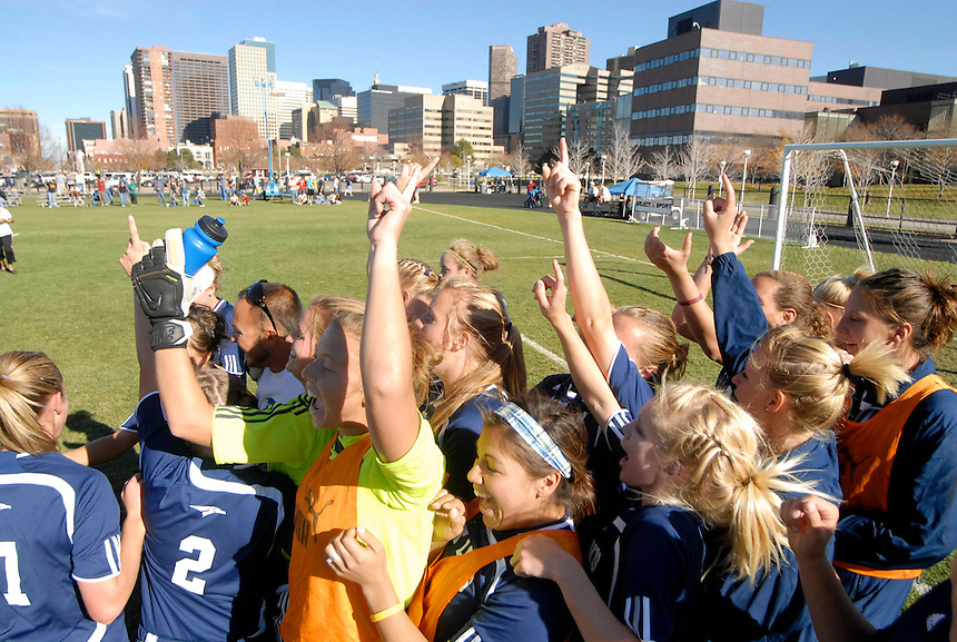 2007 RMAC women's soccer champions Fort lewis College celebrate a win in Denver, Colorado.