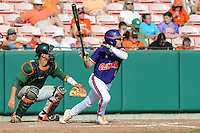 Right Fielder Dominic Attanasio #1 swings at a pitch during a  game against the Miami Hurricanes at Doug Kingsmore Stadium on March 31, 2012 in Clemson, South Carolina. The Tigers won the game 3-1. (Tony Farlow/Four Seam Images).