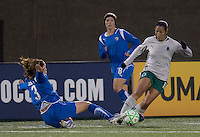 Boston Breakers forward Kelly Schmedes (3) slide tackles St Louis Athletica midfielder Daniela Alves Lima (10). The Boston Breakers defeated Saint Louis Athletica, 2-0, at Harvard Stadium on April 11, 2009.
