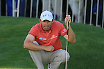 Padraig Harrington eyeing up his putt on the 18th.during round three of the BMW PGA championship 2010 at Wentworth golf club, Surrey England..Picture Fran Caffrey/Newsfile.ie