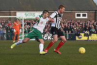 Craig Disley of Grimsby Town is challenged by Dan Beck of Bognor Regis Town during the FA Trophy Semi Final first leg match between Bognor Regis and Grimsby Town at Nyewood Lane, Bognor Regis, England on 12 March 2016. Photo by Paul Paxford/PRiME Media Images.