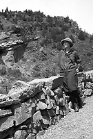 Woman stands next to a rock wall , circa 1930's.   (photo: www.bcpix.com)