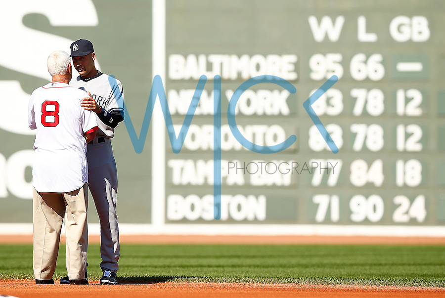 Derek Jeter #2 of the New York Yankees is greeted by former Boston Red Sox player and hall of famer, Carl Yastrzemski, during pregame ceremonies at Fenway Park in Jeter's final career game on September 27, 2014 in Boston, Massachusetts. (Photo by Jared Wickerham for the New York Daily News)