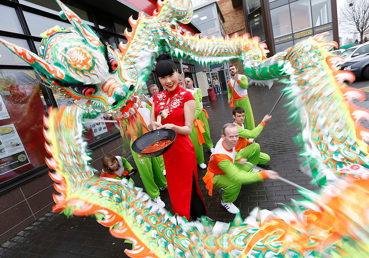 Monday, 28th January 2013: .Model Yomiko Chen along with dragon dancers from the Lung Ying Academy, pictured celebrating the Chinese New Year with Uncle Ben's at SuperValu in Palmerstown, Co. Dublin. Pic. Robbie Reynolds/CPR..Celebrate Chinese New Year this February with a wide range of inspirational oriental recipes to transform familiar family meals with Uncle Ben's. Perfect for busy people who are always on the go - you can make something simply delicious for dinner in minutes with Uncle Ben's range of flavour packed, authentic oriental sauces and rice. .For simply delicious good food at home, recreate your favourite Chinese restaurant dishes in your kitchen faster than the time it takes to order. It's easy when you Begin with Ben to cook tasty meals -with healthier eating and lifestyles increasingly driving meal-planning and trolley decisions..Like Chinese cuisine, like us on Facebook at www.facebook.com/unclebensireland.-
