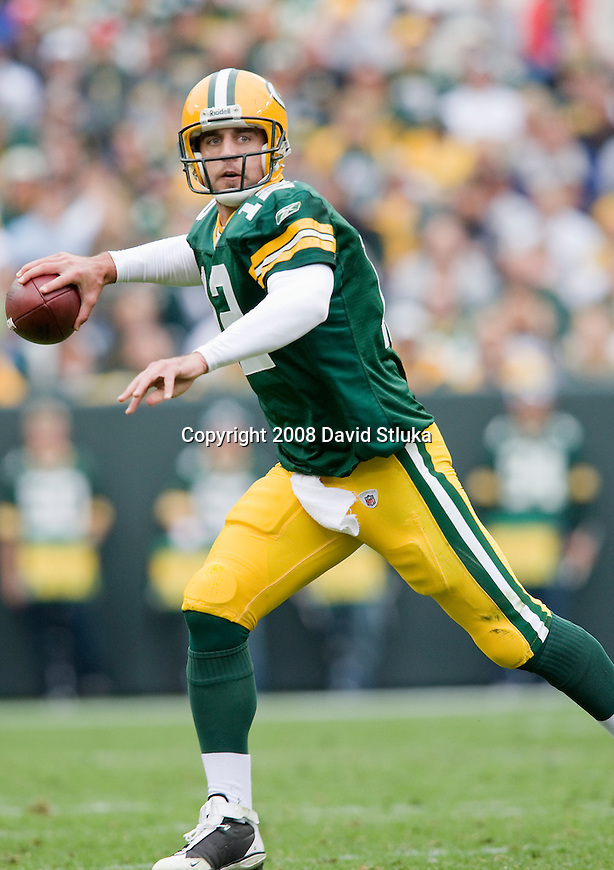 GREEN BAY, WI - OCTOBER 5: Quarterback Aaron Rodgers #12 of the Green Bay Packers throws a pass against the Atlanta Falcons at Lambeau Field on October 5, 2008 in Green Bay, Wisconsin. The Falcons beat the Packers 27-24. (Photo by David Stluka)