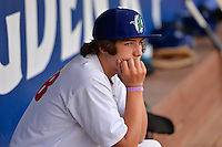 Ogden Raptors batboy prior to the game against the Idaho Falls Chukars in Pioneer League action at Lindquist Field on July 26, 2014 in Ogden, Utah.  (Stephen Smith/Four Seam Images)