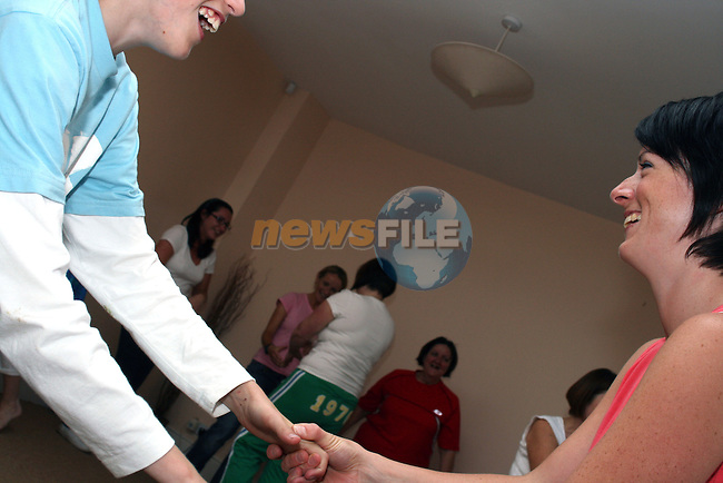 Participants in the Laughter Yoga class in Drogheda run by Aisling Coleman  practice their greeting laughter....Photo NEWSFILE/Jenny Matthews.(Photo credit should read Jenny Matthews/NEWSFILE)....This Picture has been sent you under the condtions enclosed by:.Newsfile Ltd..The Studio,.Millmount Abbey,.Drogheda,.Co Meath..Ireland..Tel: +353(0)41-9871240.Fax: +353(0)41-9871260.GSM: +353(0)86-2500958.email: pictures@newsfile.ie.www.newsfile.ie.FTP: 193.120.102.198.