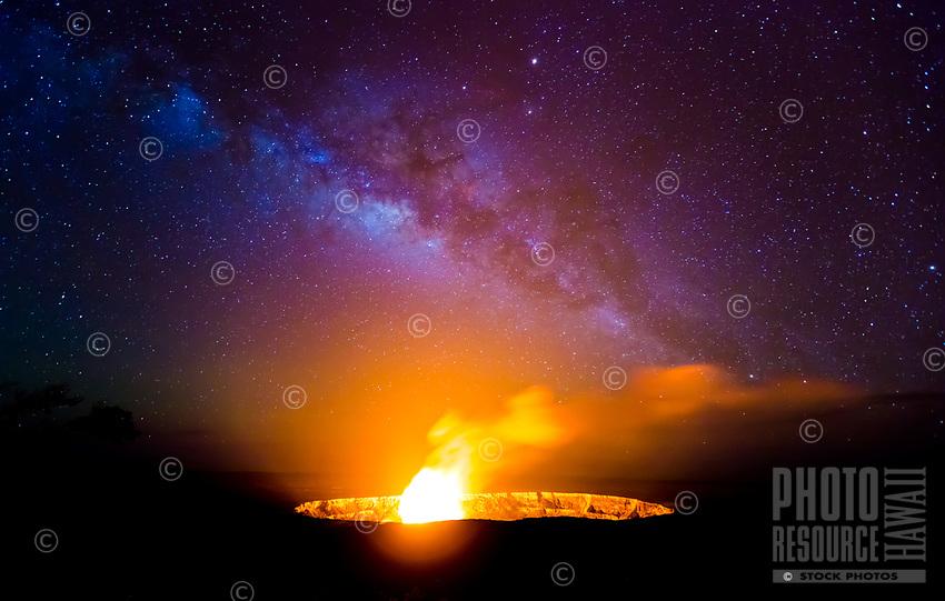 Halema'uma'u Under the Milky Way: The Milky Way rises above Halema'uma'u Crater as lava spatters over the lava lake's rim, a rare event at Hawai'i Volcanoes National Park, Big Island.