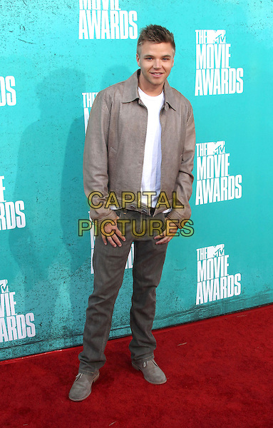 Brett Davern.2012 MTV Movie Awards held at the Gibson Amphitheatre, Universal City, California, USA..3rd June 2012.full length white top beige leather jacket jeans denim.CAP/ADM/SLP/LS.©Lee Sherman/Starlitepics/AdMedia/CapitalPictures.