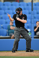 Home plate umpire Ryan Benson makes a call during a game between the Daytona Cubs and Dunedin Blue Jays on April 14, 2014 at Florida Auto Exchange Stadium in Dunedin, Florida.  Dunedin defeated Daytona 1-0  (Mike Janes/Four Seam Images)
