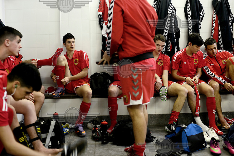 Players from the Gibraltarian under-17 national team  get changed prior to a match against Northern Ireland played in March 2013. Although the United Nations doesn't recognise Gibraltar as an independent country, UEFA has recognised it and has granted the British Overseas Territory full UEFA membership.