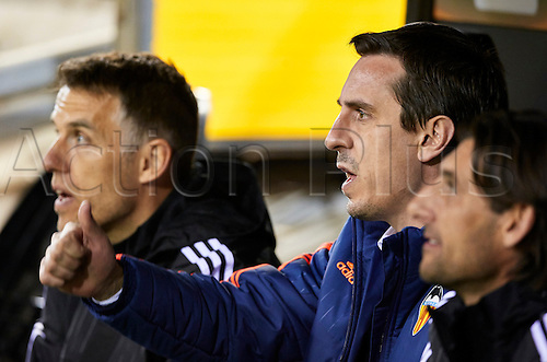 18.02.2016. Mestalla Stadium, Valencia, Spain. Europa League. Valencia versus Rapid Wien. Valencia CF Head coach Gary Neville (R) and his brother Phil Neville gesture