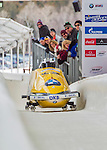 9 January 2016: Germany pilot Nico Walther leads his 4-man team as they cross the finish line after their second run of the day at the BMW IBSF World Cup Bobsled Championships at the Olympic Sports Track in Lake Placid, New York, USA. Walther's team ended the day in 13th place with a 2-run combined time of 1:51.23. Mandatory Credit: Ed Wolfstein Photo *** RAW (NEF) Image File Available ***