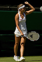 Gisela Dulko (ARG) against Maria Sharapova (Rus) (24) in the second round of the ladies singles. Dulko beat Sharapova 6-2 3-6 6-4..Tennis - Wimbledon - Day 3 - Wed  24th June 2009 - All England Lawn Tennis Club  - Wimbledon - London - United Kingdom..Frey Images, Barry House, 20-22 Worple Road, London, SW19 4DH.Tel - +44 20 8947 0100.Cell - +44 7843 383 012