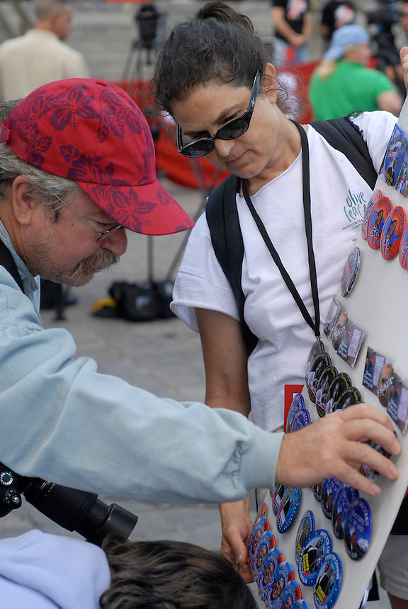 24 Aug 08: A vendor displays pins for sale at the Colorado state capitol building. Hundreds of individual vendors have goods available the week of the convention. On the day before the Democratic National Convention is scheduled to begin about 1,500 people participated in the ReCreate 68 rally, which included a march from the Colorado state capitol building to the Pepsi Center.