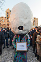 Moscow, Russia, 15/12/2012..A man wearing an egg for a head and signs reading ?The Eggman is just walking? and ?The Eggman does not go to unauthorised rallies? in Lubyanka Square at an unauthorised opposition rally to mark a year of protests against Vladimir Putin.