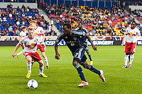 C.J. Sapong (17) of Sporting Kansas City is marked by Dax McCarty (11) of the New York Red Bulls. Sporting Kansas City defeated the New York Red Bulls 1-0 during a Major League Soccer (MLS) match at Red Bull Arena in Harrison, NJ, on April 17, 2013.