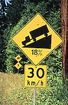 Road sign cautions trucks of an 18% grade.