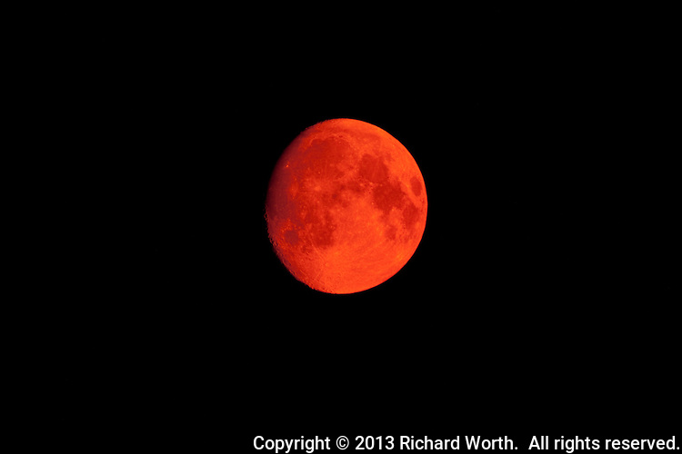 Colorado wildfires filled the sky with smoke which turned the moon a red-orange color a few days before the June super moon.