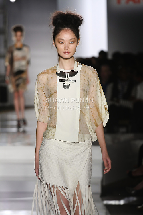 Model walks runway in an outfit by Andria Crescioni, for the Parsons 2011 BFA Fashion Show, hosted by Reed Krakoff.