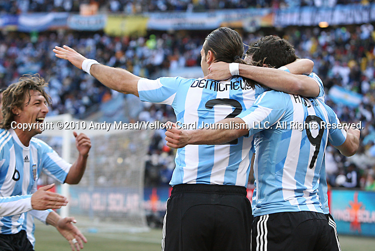 17 JUN 2010:  Gonzalo Higuain (ARG)(9), Martin Demichelis (ARG)(2), and Gabriel Heinze (ARG)(6) celebrates Higuain's game winning goal.  The Argentina National Team defeated the South Korea National Team 4-1 at Soccer City Stadium in Johannesburg, South Africa in a 2010 FIFA World Cup Group E match.