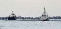 United States Coast Guard ship 105 keeps the St. Clair River channel clear of ice for the north bound barge Norman McLeod.