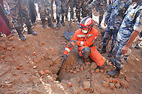 Rescue workers using cameras during a search operation in a collapse site in Pathan, Kathmandu, Nepal.