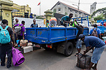 28 August 2019, Jakarta, Indonesia: - African refugees from Somalia and Ethiopia packing their belongings onto trucks outside the UNHCR refugee centre in Kalideres, Jakarta. Plans to re-locate the overcrowded refugees have been fast tracked after a fight broke out between the groups, many of whom have been in Indonesia for years waiting for placement. Tensions ran high between Afghan and African groups in the centre with a lack of adequate food for the refugees being the catalyst. The African groups, who were moved onto the footpath, were being bussed out today. Conditions in the centre are grim and the local Indonesian population not happy with the refugees presence in the suburb.Picture by Graham Crouch/The Australian