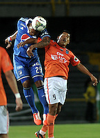 BOGOTA - COLOMBIA – 21-08-2014: Roman Torres (Izq.) jugador de Millonarios de Colombia disputa el balon con Andy Pando (Der.) jugador de Universidad Cesar Vallejo C. F. de Peru, durante partido de ida de la primera fase, llave G14 de la Copa Total Suramericana entre Millonarios de Colombia y Universidad Cesar Vallejo Club de Futbol de Peru, en el estadio Nemesio Camacho El Campin de la ciudad de Bogota. / Roman Torres (L) player of Millonarios of Colombia vies for the ball with Andy Pando (R) jugador of Universidad Cesar Vallejo C. F. of Peru, during a match for the first leg, of the first phase, Key G14 between Millonarios de Colombia and Universidad Cesar Vallejo Club de Futbol of Peru of the Copa Total Suramericana in the Nemesio Camacho El campin Stadium in Bogota city. Photos: VizzorImage / Luis Ramirez / Staff.