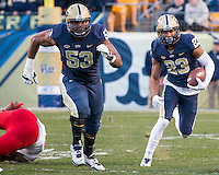 Pitt offensive guard Dorian Johnson (53) blocks for Pitt wide receiver Tyler Boyd (23) on a jet sweep. The Pitt Panthers football team defeated the Louisville Cardinals 45-34 on Saturday, November 21, 2015 at Heinz Field, Pittsburgh, Pennsylvania.