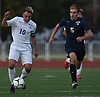 Savvas Christoforou #10 of Port Washington, left, moves the ball upfield during his team's 1-0 win over Massapequa in the Nassau County varsity boys soccer Class AA final at Mitchel Athletic Complex in Uniondale on Wednesday, Oct. 31, 2018. He scored the lone goal early in the second half.