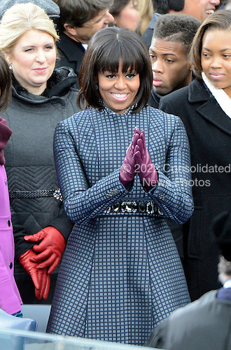 First lady Michelle Obama acknowledges the crowd after arriving for United States President Barack Obama taking the oath of office during the public swearing-in ceremony at the U.S. Capitol in Washington, D.C. on Monday, January 21, 2013..Credit: Ron Sachs / CNP.(RESTRICTION: NO New York or New Jersey Newspapers or newspapers within a 75 mile radius of New York City)