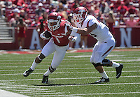 NWA Democrat-Gazette/Michael Woods --04/25/2015--w@NWAMICHAELW... University of Arkansas receiver Jared Cornelius is pushed out of bounds by defender Matt Reynolds during the 2015 Red-White game Saturday afternoon at Razorback Stadium in Fayetteville.
