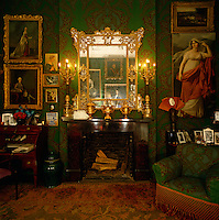 Gilt, candlelight and intense colour have created this warm and intimate London bedroom