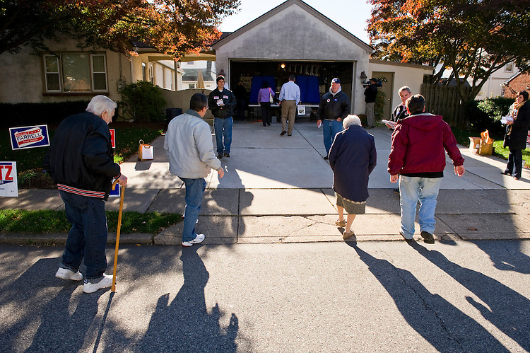 DREXEL HILL, PA - Nov 02: Voters arrive to vote. The polling place is where 7th congressional district Republican candidate Pat Meehan votes. The poll is in a private garage in his neighborhood. (Photo by Scott J. Ferrell/Congressional Quarterly)