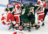 Britt Hergesheimer (BU - 2), Jill Cardella (BU - 22) and Jenelle Kohanchuk (BU - 19) begin to celebrate Cardella's goal as the Catamounts being to protest. - The Boston University Terriers tied the visiting University of Vermont Catamounts 2-2 on Saturday, November 13, 2010, at Walter Brown Arena in Boston, Massachusetts.