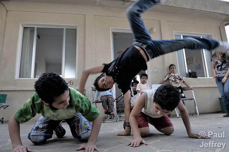 Children playing in a shelter outside Beirut for Iraqi refugees and other residents of Lebanon who have suffered from domestic violence. The shelter, a program of the Caritas Lebanon Migrant Center, which is funded by Catholic Relief Services, the relief and development agency of the U.S. Catholic community, is located in an unnamed community on the outskirts of Beirut.