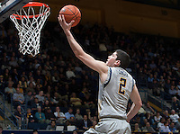 Sam Singer of California tosses the ball into a basket during the game against Washington at Haas Pavilion in Berkeley, California on January 15th 2014.  California defeated Washington, 82-56.