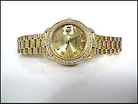 BNPS.co.uk (01202 558833)<br /> Pic: SheffieldAuctionGallery/BNPS<br /> <br /> ***Please use full byline***<br /> <br /> Rolex; An 18ct Gold Oyster Perpetual Datejust Diamond Set Lady's Wristwatch<br /> <br /> A &pound;110,000 haul of jewellery seized from the ringleader of a &pound;26million tobacco smuggling operation is to go under the hammer.<br /> <br /> The collection includes a luxurious 9-carat diamond ring valued at &pound;40,000 and four jewel-encrusted designer wristwatches collectively worth &pound;30,000.<br /> <br /> Also among the 30 lots are an &pound;8,000 4.5 carat single stone ring, large 7-carat ear studs worth &pound;15,000 and a bizarre solid gold baby's dummy worth &pound;500.<br /> <br /> The items were confiscated from Daniel Harty, the mastermind of a criminal gang jailed for smuggling 150 million cigarettes and two tonnes of low quality tobacco into the UK.<br /> <br /> Harty created a distribution network around the north of England transporting cigarettes to warehouses, storage yards and farms.<br /> <br /> Between them they evaded paying &pound;26million of duty.<br /> <br /> Harty, 30, from Doncaster, Yorks, was jailed in June last year for four and a half years after pleading guilty to conspiracy to evade excise duty.<br /> <br /> The jewellery was seized from Harty on his arrest in early 2011 under the Proceeds of Crime Act. A judge ordered it should be sold to satisfy a &pound;330,000 confiscation order.<br /> <br /> The auction is being held at Sheffield Auction Gallery on March 21.