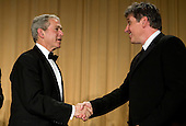 26 April 2008 - Washington, D.C. - President George W. Bush shakes hands with actor Craig Ferguson following his monologue during the White House Correspondents Association Dinner. Photo Credit: Kristoffer Tripplaar/ Sipa Press