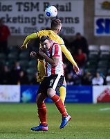 Lincoln City's Matt Rhead vies for possession with Chester's Wade Joyce<br /> <br /> Photographer Andrew Vaughan/CameraSport<br /> <br /> Vanarama National League - Lincoln City v Chester - Tuesday 11th April 2017 - Sincil Bank - Lincoln<br /> <br /> World Copyright &copy; 2017 CameraSport. All rights reserved. 43 Linden Ave. Countesthorpe. Leicester. England. LE8 5PG - Tel: +44 (0) 116 277 4147 - admin@camerasport.com - www.camerasport.com