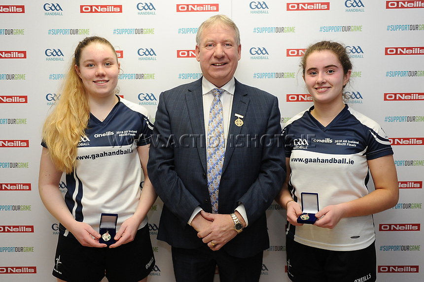 07/04/2018; GAA Handball O&rsquo;Neills 40x20 Championship Final Girls Minor Doubles Clare (Catriona Millane/Bridin Dinan) v Kildare (Leah Doyle/Molly Dagg); Kingscourt, Co Cavan;<br /> Winners Leah Doyle and Molly Dagg with GAA Handball President Joe Masterson.<br /> Photo Credit: actionshots.ie/Tommy Grealy