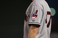 The Cleveland Indians logo is shown on the sleeve of an AZL Indians 2 coach during an Arizona League game against the AZL Angels at Tempe Diablo Stadium on June 30, 2018 in Tempe, Arizona. The AZL Indians 2 defeated the AZL Angels by a score of 13-8. (Zachary Lucy/Four Seam Images)