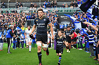 Charlie Ewels, mascot in hand, leads the Bath Rugby team onto the field. European Rugby Challenge Cup Quarter Final, between Bath Rugby and CA Brive on April 1, 2017 at the Recreation Ground in Bath, England. Photo by: Patrick Khachfe / Onside Images