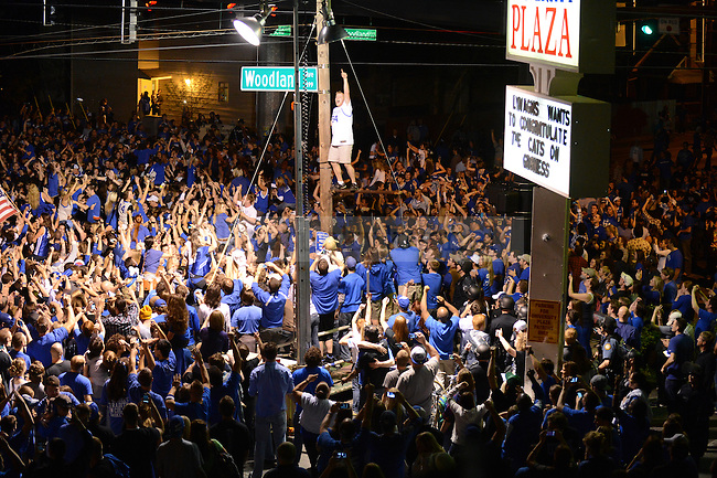UK fans celebrate at the intersection of Woodland Ave. and Euclid Ave. in Lexington, Ky., after their victory over Kansas in the NCAA Basketball Championship game on 4/3/12. Photo by Mike Weaver | Staff