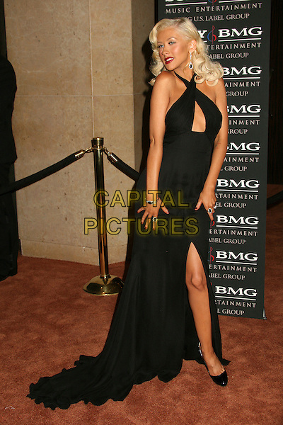 CHRISTINA AGUILERA.Clive Davis 2007 Pre-Grammy Awards Party at the Beverly Hilton Hotel, Beverly Hills, USA..February 10th, 2007.full length black halterneck dress peephole cut out legs slit split gown long train shoes cleavage.CAP/ADM/BP.©Byron Purvis/AdMedia/Capital Pictures