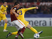 Calcio, Champions League: Gruppo E - Roma vs Bate Borisov. Roma, stadio Olimpico, 9 dicembre 2015.<br /> Bate Borisov's Denis Polyakov, right, is challenged by Roma's Alessandro Florenzi during the Champions League Group E football match between Roma and Bate Borisov at Rome's Olympic stadium, 9 December 2015.<br /> UPDATE IMAGES PRESS/Isabella Bonotto